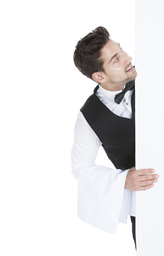 Young butler looking at blank billboard isolated over white background